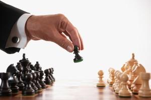 bigstock_Businessman_Playing_Chess_Game